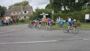 Race leaders taking the corner at the cross roads